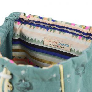 Vue de l'intérieur du sac à dos pour enfant licornes, vert.